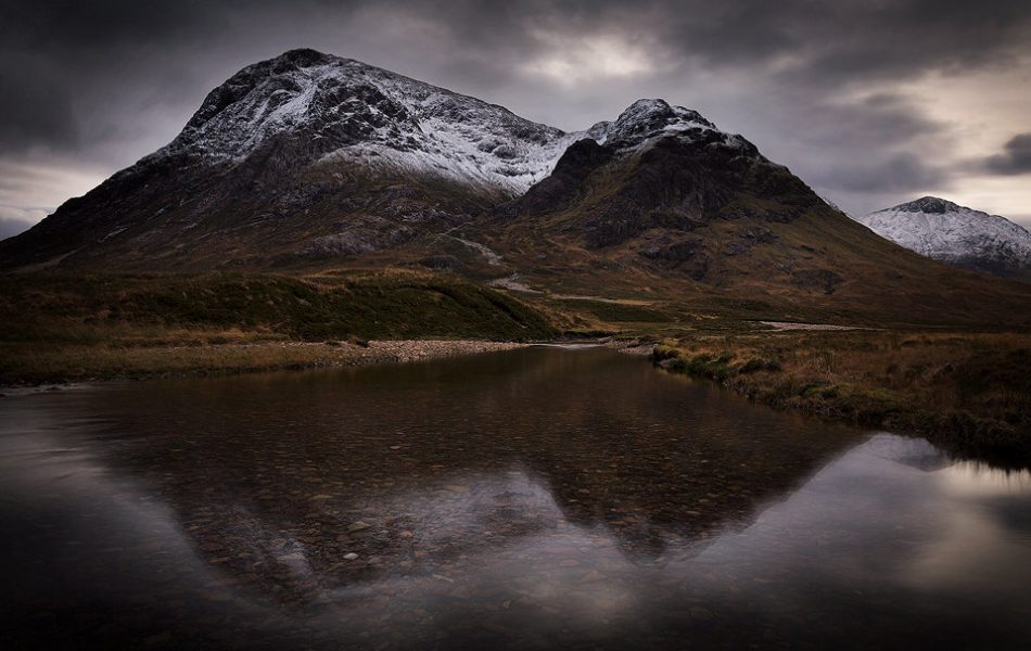 This moody image of Buachaille Etive Mòr reflected in the river Etive. It took a while to find a calm stretch of river to achieve this image, but I really like this classic composition, especially with a dusting of snow on the tops.