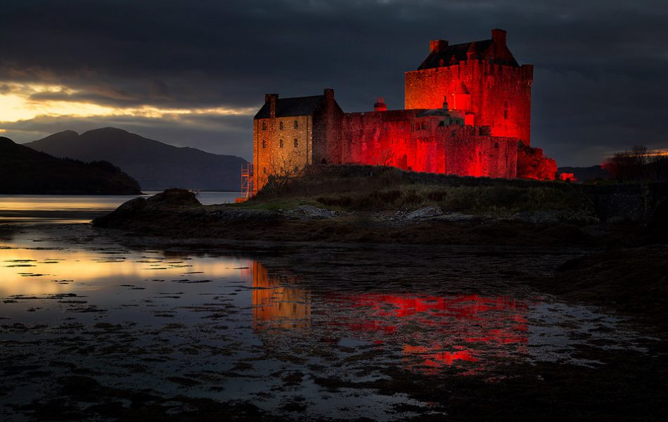 Eilean Donan castle at last light reflected in the loch.