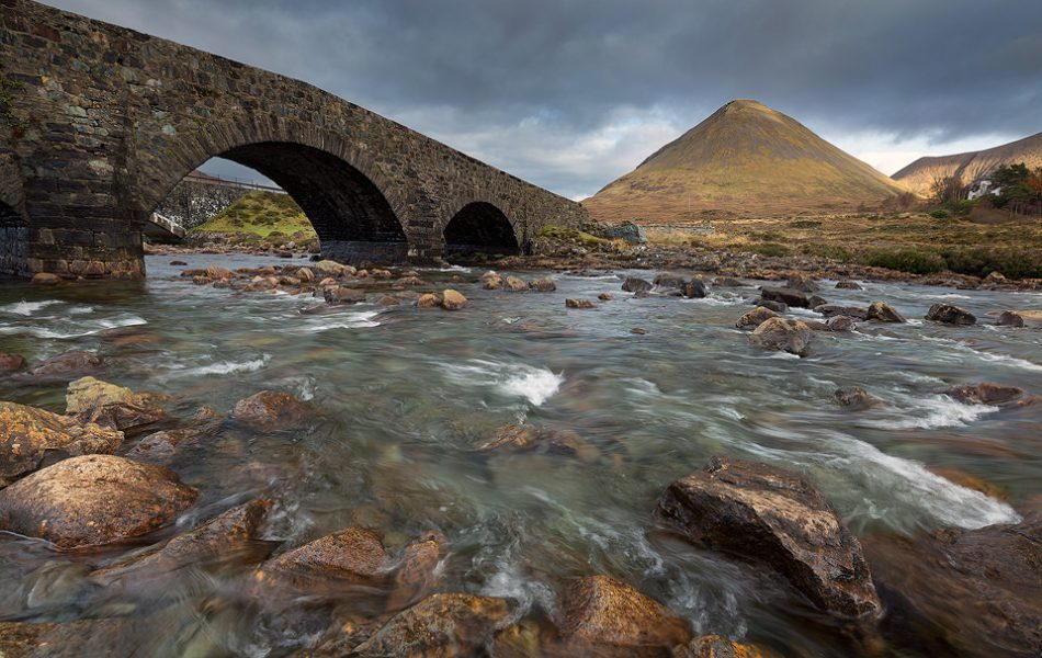 Old bridge over the River Sligachan, looking towards the Cuillin Mountains,