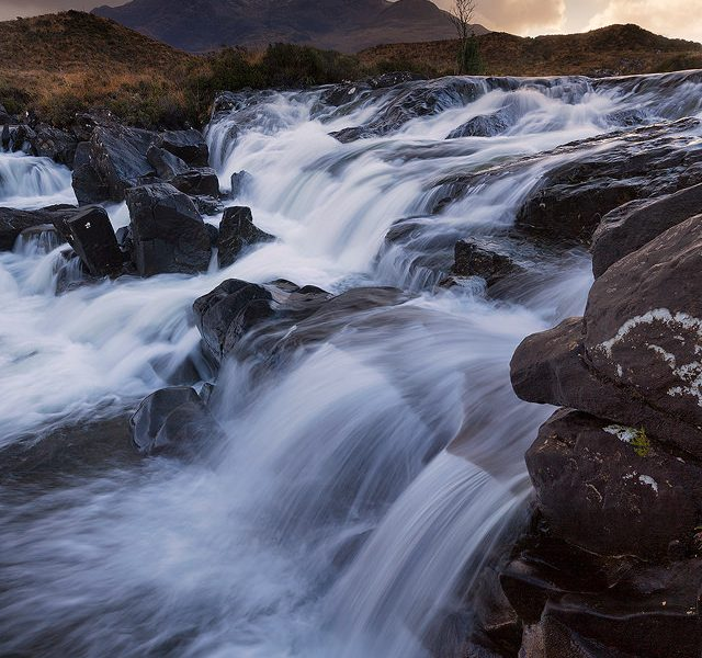 One of the dramatic cascades on Alt Dearg Mor looking towards Sgurr nan Gilean, one of the most famous Cuillin peaks. Here the many cascades along the river are perfect as foreground for the surrounding Cuillin.