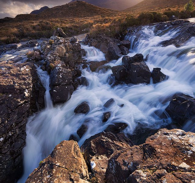 One of the dramatic cascades on Alt Dearg Mor looking towards Sgurr nan Gilean, one of the most famous Cuillin peaks.