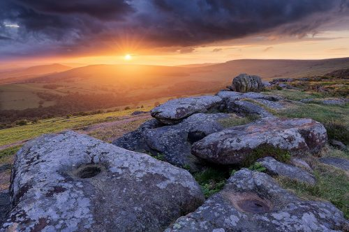 Incredible stormy sunset at the knuckle stone on Carhead rocks. Derbyshire, Peak District.