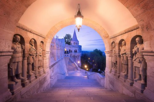 Statues of the Árpád dynasty kings at the gate to the Fisherman's Bastion during the blue hour, Budapest, Hungary.