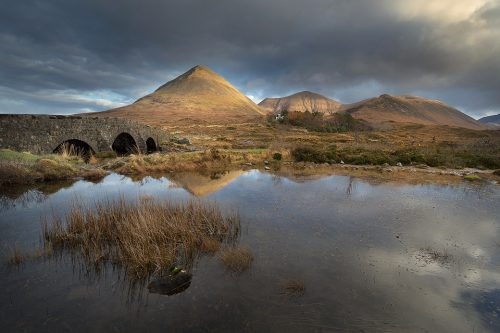 The iconic mountains of Sligachan reflected in a small lochan by the old bridge. Despite the strong winds elsewhere this small lake was perfectly still allowing for some great reflections.