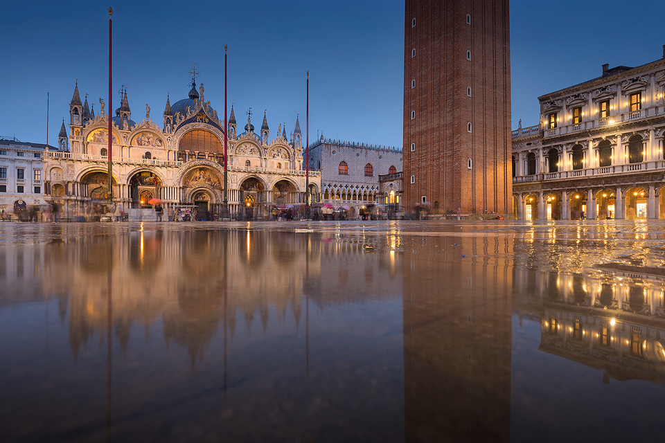 St Mark's Basilica in the blue hour, taken during a particularly wet visit to the beautiful Italian city of Venice. Although it was a holiday rather than a work trip, I still brought my camera and one lens along to do some photography. We managed to avoid floods for most of the trip, but on the last day the torrential rain started again. The heavy rain did make this image of St Mark's square reflected in a large puddle possible, but also meant we got caught out with no waterproof footwear, not much fun getting the return plane with sodden shoes and socks!