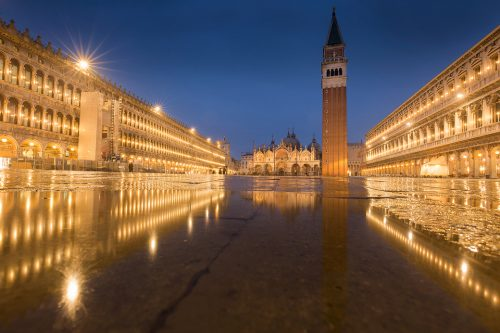 Piazza San Marco, St Mark's Basilica in the blue hour, taken during a particularly wet visit to the beautiful Italian city of Venice. Although it was a holiday rather than a work trip, I still brought my camera and one lens along to do some photography. We managed to avoid floods for most of the trip, but on the last day the torrential rain started again. The heavy rain did make this image of St Mark's square reflected in a large puddle possible, but also meant we got caught out with no waterproof footwear, not much fun getting the return plane with sodden shoes and socks!