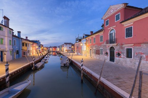 One of the many picturesque canals overlooked by the brightly coloured fishermen's houses on the Island of Burano. After a great day exploring the labyrinth of tiny streets and canals during the warm sunny day I set up to do some photography as the blue hour arrived.