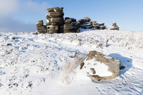 Some fantastic wintry conditions at the Wheel stoneson Derwent Edge in the Peak District National Park. The Wheel Stones (otherwise known as the Coach and Horses) sit high up behind Derwent Edge overlooking the busy A57 Snake Pass. These strange gritstone formations have been shaped by the elements battering the Derwent Moors over many years. I've visited this location many times over the years, never quite getting the right conditions. On this occasion hoar frost, snow, low cloud and some sublime light combined for a spectacular Winter wonderland.