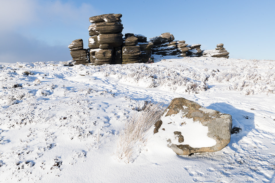 Some fantastic wintry conditions at the Wheel stones on Derwent Edge in the Peak District National Park. The Wheel Stones (otherwise known as the Coach and Horses) sit high up behind Derwent Edge overlooking the busy A57 Snake Pass. These strange gritstone formations have been shaped by the elements battering the Derwent Moors over many years. I've visited this location many times over the years, never quite getting the right conditions. On this occasion hoar frost, snow, low cloud and some sublime light combined for a spectacular Winter wonderland.