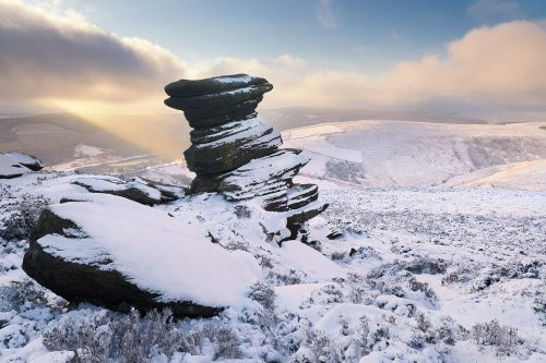 Salt Cellar in Winter. Some fantastic wintry conditions at the Salt Cellaron Derwent Edge in the Peak District National Park. I've visited this location many times over the years, never quite getting the right conditions. On this occasion hoar frost, snow, low cloud and some sublime light combined for a spectacular Winter wonderland.On this afternoon I was blessed with some stunning conditions, particularly when this well defined beam of light broke through the clouds illuminating the snowy hills in the distance.