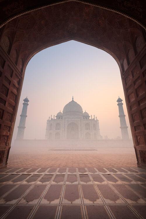 Taj Mahal Mosque. Taj Mahal viewed from inside one of the mosques archways at sunrise, Agra, Uttar Pradesh, India.