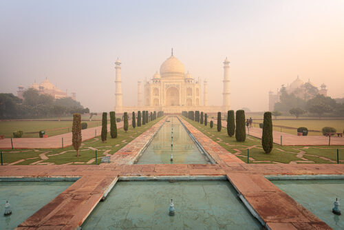 Classic view of the Taj Mahal across the landscaped lawns and fountains from the Diana bench, Agra, Uttar Pradesh, India.