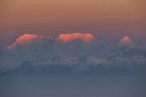 Telephoto view of some of the worlds highest mountains at first light; Chamlang Ridge (7319m) and Baruntse (7129m). Sandakphu, West Bengal, India.