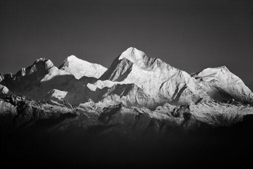 Telephoto view of some of the worlds highest mountains; Lhotse (8516 m), Mt Everest (8848 m), Makalu (8485 m) and Chomo Lonzo (7540 m). Sandakphu, West Bengal, India.
